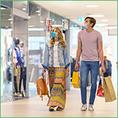 Country & Sector Risk Barometer: Q1 2021 Quarterly Update. The photo shows a young couple wearing masks, browsing in a shopping centre.